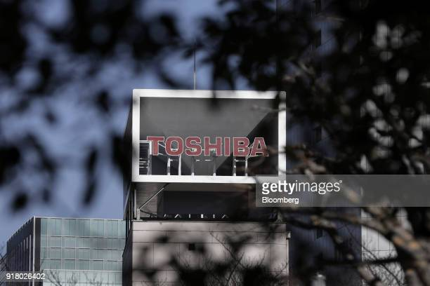 Signage for Toshiba Corp is displayed at the company's headquarters in Tokyo Japan on Wednesday Feb 14 2018 Toshiba announced Wednesday that Nobuaki...