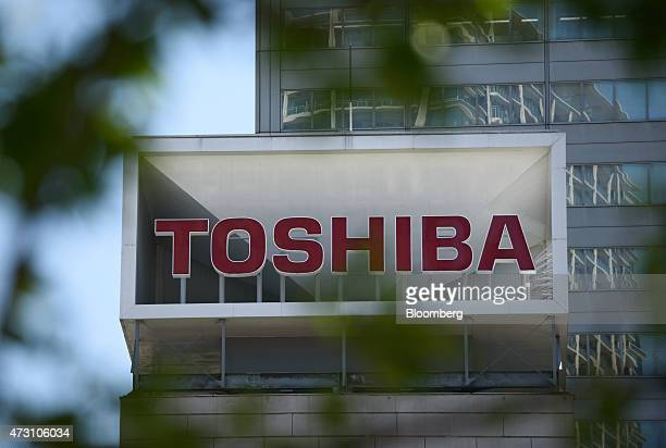 Signage for Toshiba Corp is displayed atop the company's headquarters in Tokyo Japan on Wednesday May 13 2015 An accounting probe of Toshiba's...
