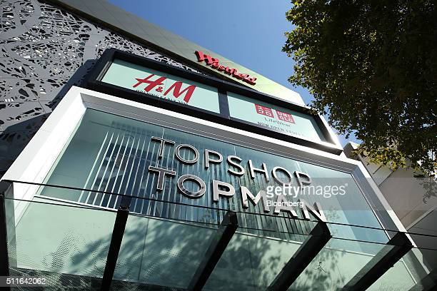 Signage for Westfield Corp., top, Hennes & Mauritz AB , center left, Fast Retailing Co.'s Uniqlo, center right, and Topshop and Topman stores are...