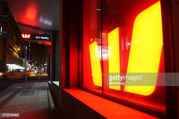 Signage for Westpac Banking Corp is illuminated at night in a window of one of the bank's office buildings in Melbourne Australia on Friday May 1...
