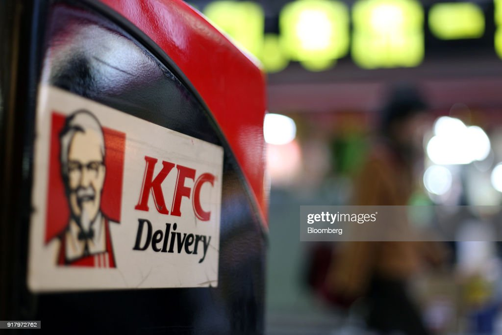 Signage for Yum! brands Inc. Kentucky Fried Chicken (KFC) is displayed on a delivery motorbike parked outside a restaurant in Yokohama, Japan, on Saturday, Feb. 3, 2018. Japans economy expanded for an eighth quarter, with its gross domestic product (GDP) grew at an annualized rate of 0.5 percent in the three months ended Dec. 31, but the pace of growth fell sharply and missed expectations. Photographer: Takaaki Iwabu/Bloomberg via Getty Images