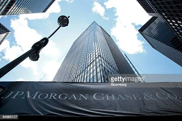Signage hangs on scaffolding outside the headquarters of JPMorgan Chase Co at 270 Park Avenue in New York US on Tuesday July 14 2009 JPMorgan Chase...