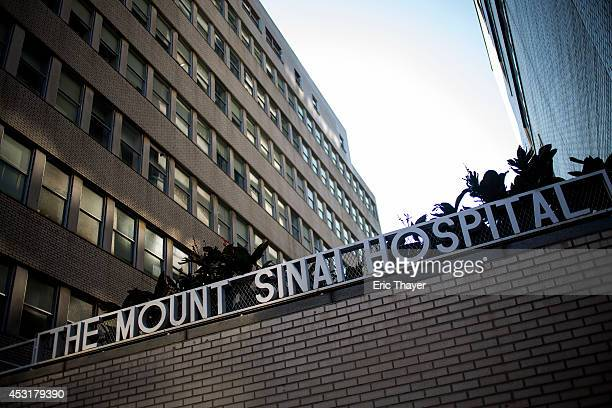 Signage hangs outside Mount Sinai Hospital on August 4 2014 in New York City Doctors at the Manhattanlocated hospital were reportedly testing a man...
