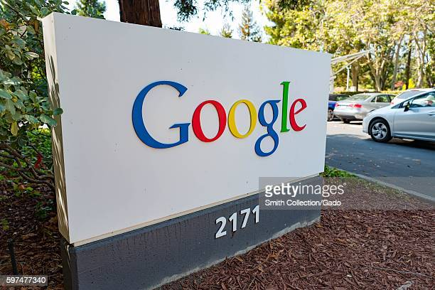 Signage in a wooded area featuring a Google logo at the Googleplex headquarters of the search engine company Google in the Silicon Valley town of...