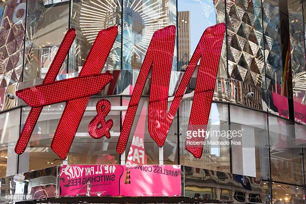 M signage in red on the glass facade of a building in New York city Hennes Mauritz AB is a Swedish multinational retailclothing company known for its...