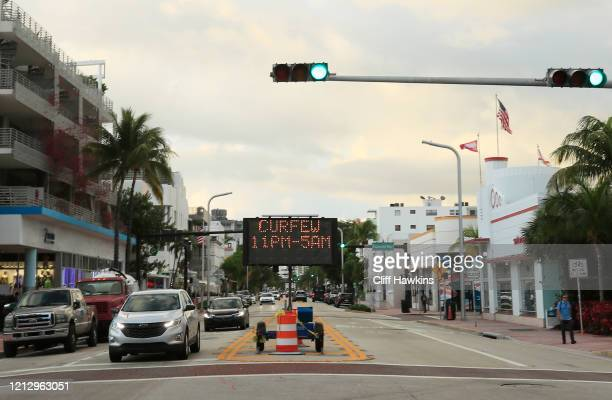 Signage indicates a curfew from 11pm until 5am that the city put in place in an effort to prevent the spread of the coronavirus on March 17, 2020 in...