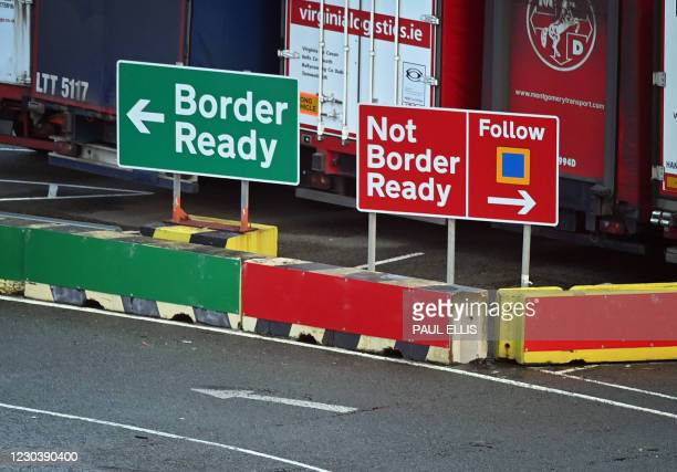 Signage indicates the direction vehicles should follow depending on the relevant paperwork for crossing to Ireland at the check-in area at Holyhead...