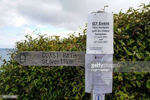 Signage informing the public of the closure of pathways adjacent to the Carbis Bay Hotel, host venue for the G7 Summit conferences, on June 03, 2021...