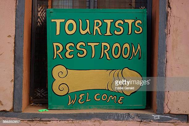A signage instructing tourists where to find the toilet in the village of Sopsokha in Punahka region of Bhutan