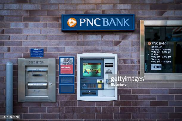 Signage is displayed above an automatic teller machine at the drivethru lane of a PNC Financial Services Group Inc bank branch in Chicago Illinois US...