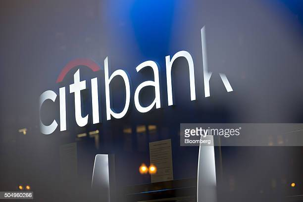 Signage is displayed above automatic teller machines at a Citigroup Inc Citibank branch in Washington DC US on Thursday Jan 7 2016 Citigroup Inc is...