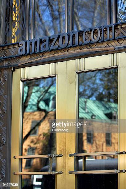 Signage is displayed above the entrance to the headquarters of Amazoncom Inc in Seattle Washington US on Tuesday April 21 2009 Amazon the world's...