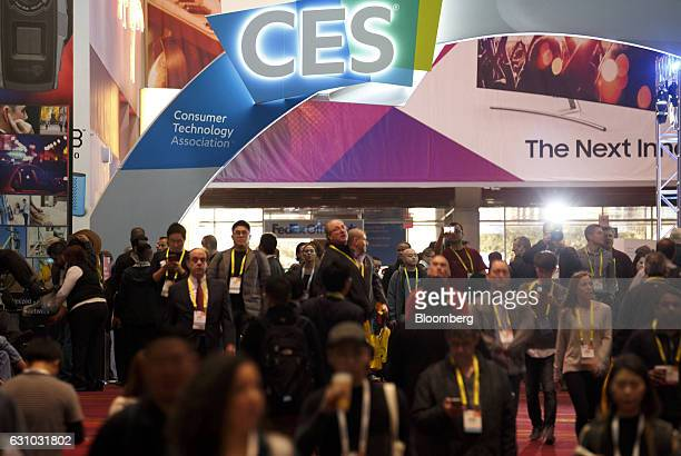 Signage is displayed as attendees walk the floor during the 2017 Consumer Electronics Show in Las Vegas Nevada US on Thursday Jan 5 2017 CES...