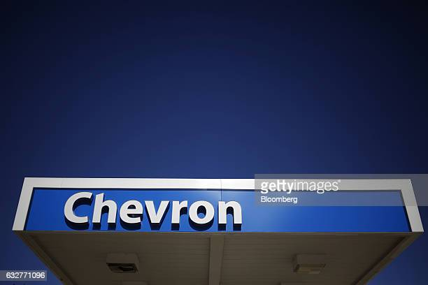 Signage is displayed at a Chevron Corp gas station in Guild Tennessee US on Tuesday Jan 24 2017 Chevron Corp is expected to release earnings figures...