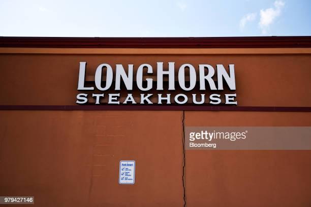 Signage is displayed at a Darden Restaurants Inc Longhorn Steakhouse location in San Antonio Texas US on Monday June 11 2018 Darden Restaurants Inc...