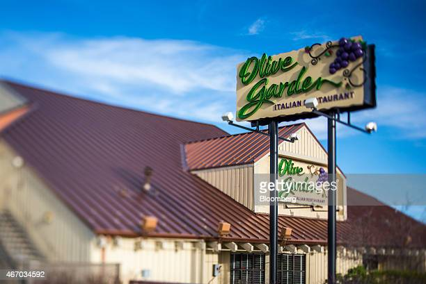 Signage is displayed at a Darden Restaurants Inc Olive Garden location in this photograph taken with a tiltshift lens in Reno Nevada US on Thursday...