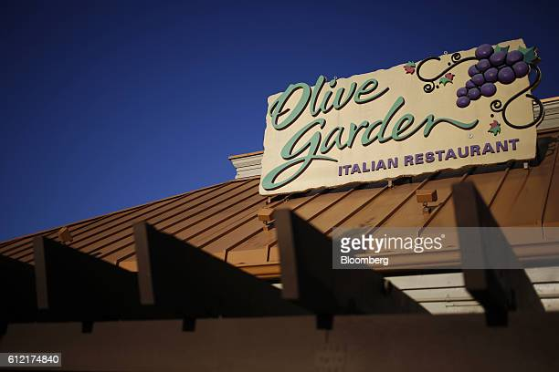 Signage is displayed at a Darden Restaurants Inc Olive Garden location in Louisville Kentucky US on Tuesday Sept 27 2016 Darden Restaurants Inc is...