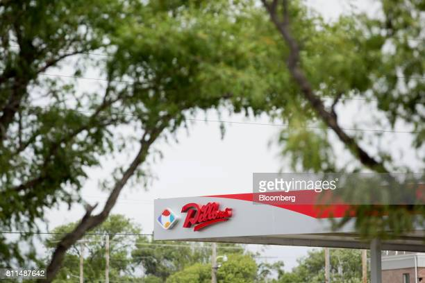 Signage is displayed at a Dillons Food Stores gas station owned by Kroger Co in Hays Kansas US on Thursday June 29 2017 Kroger remains committed to...