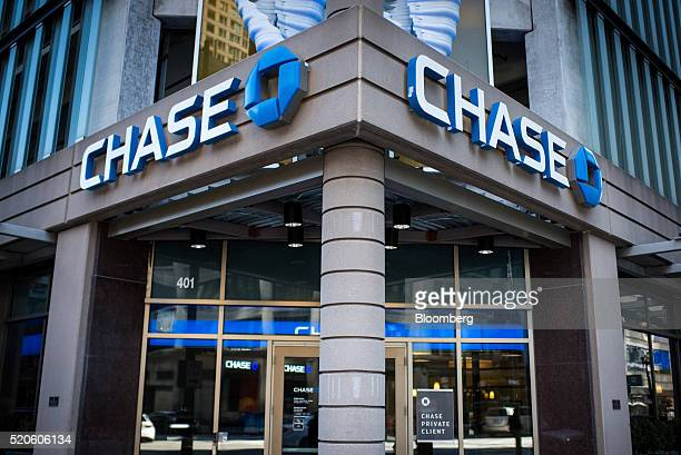 Signage is displayed at a JPMorgan Chase Co bank branch in Chicago Illinois US on Saturday April 9 2016 JPMorgan Chase Co is scheduled to report...