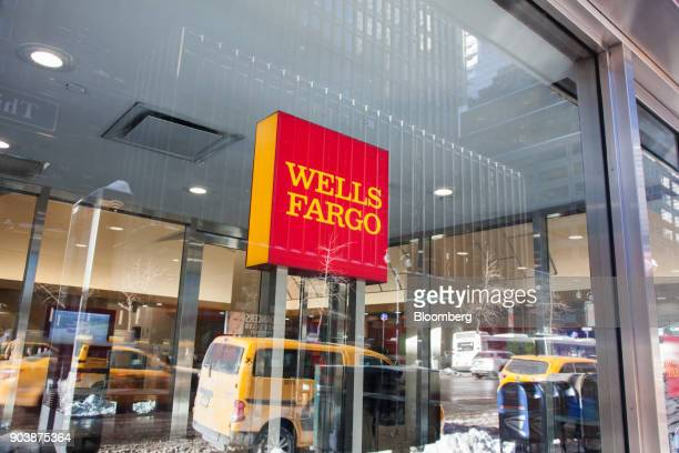 Signage is displayed at a Wells Fargo Co bank branch in New York US on Friday Jan 5 2018 Wells Fargo Co is scheduled to release earnings figures on...