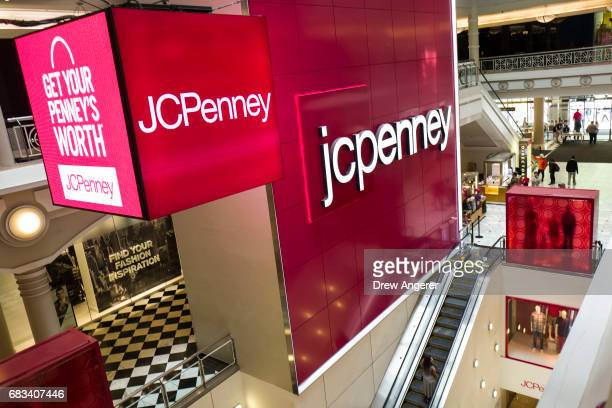 Signage is displayed at the entrance of a JC Penney department store inside the Manhattan Mall May 15 2017 in the Herald Square neighborhood in New...