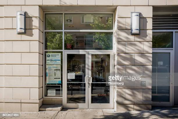Signage is displayed at the entrance to an Internal Revenue Service office building in the East Harlem neighborhood of New York US on Saturday June...