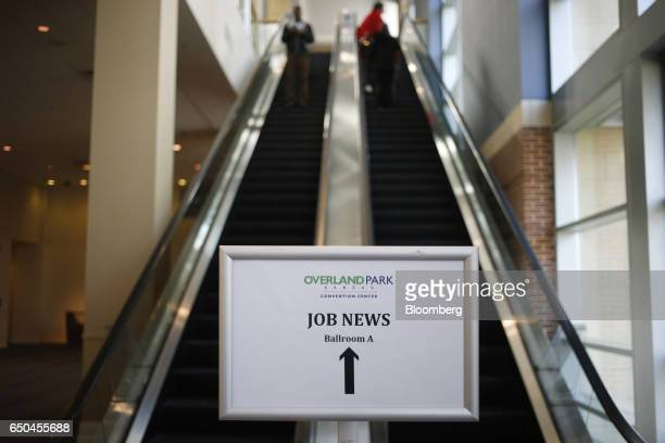 Signage is displayed at the Job News USA career fair in Overland Park Kansas US on Wednesday March 8 2017 Applications for US jobless benefits...