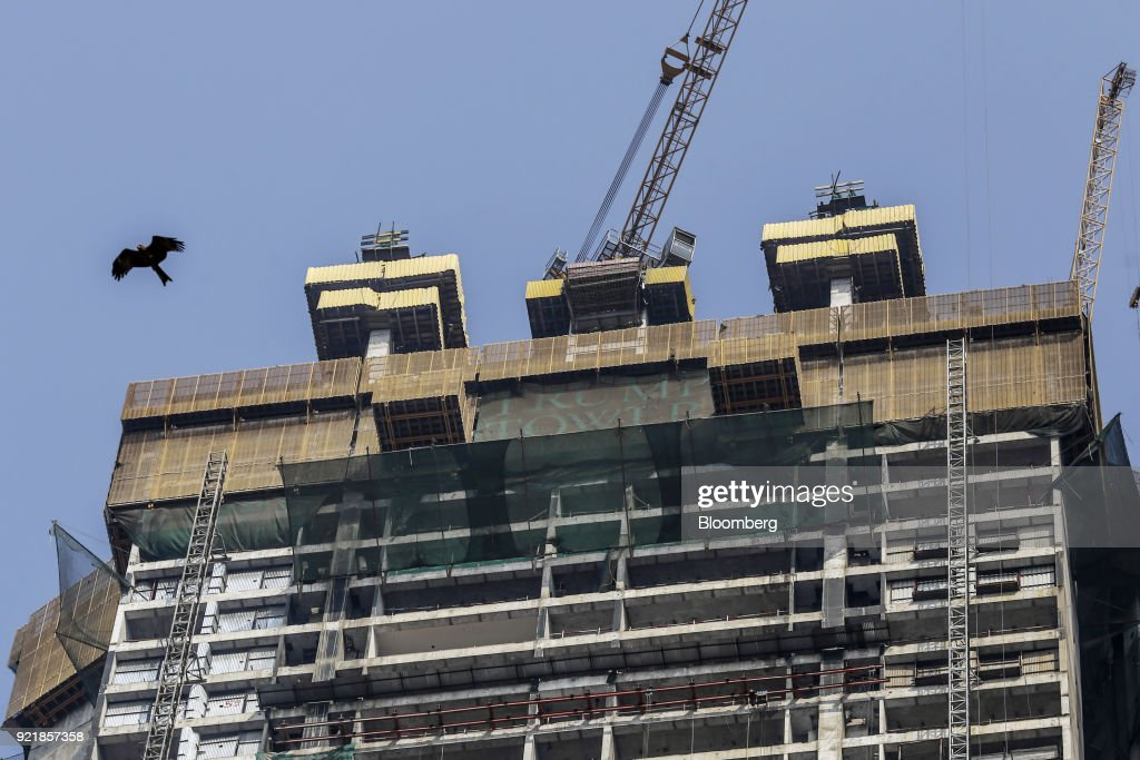 Signage is displayed atop one of two towers of Trump Tower Mumbai under construction at Lodha The Park, a luxury residential project developed by Lodha Developers Ltd., in Mumbai, India, on Tuesday, Feb. 20, 2018. India has the most construction projects with Trump licensing deals of any country outside of the U.S. Photographer: Dhiraj Singh/Bloomberg via Getty Images