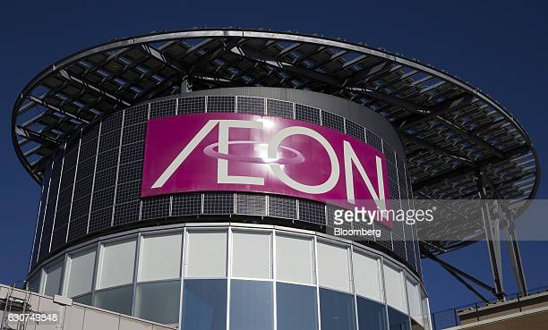 A signage is displayed atop the Aeon Lake Town shopping mall operated by Aeon Retail Co a unit of Aeon Co in Koshigaya Saitama Japan on Sunday Jan 1...