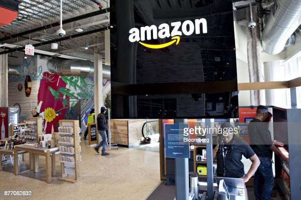 Signage is displayed in at an Amazoncom Inc PopUp store inside the Lakeview Whole Foods Market Inc store in Chicago Illinois US on Monday Nov 20 2017...
