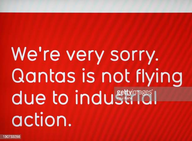 Signage is displayed in departures to advise Qantas passengers about flight cancellations at Perth Domestic Terminal on October 29 2011 in Perth...