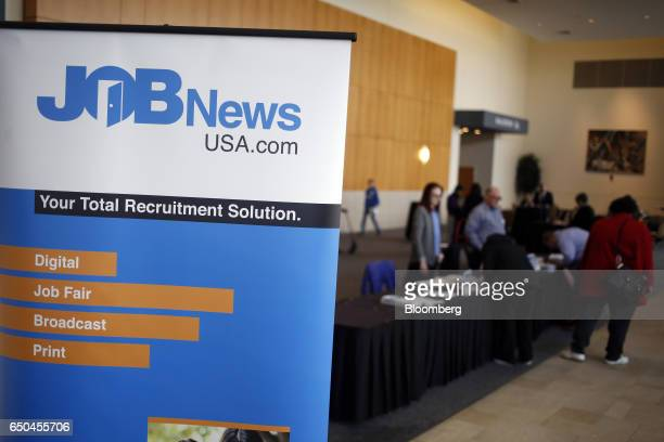 Signage is displayed in the lobby outside a Job News USA career fair in Overland Park Kansas US on Wednesday March 8 2017 Applications for US jobless...
