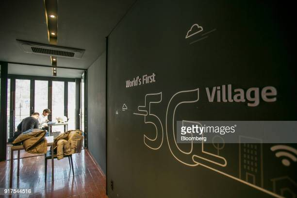 Signage is displayed inside the 5G Village Cafe in Uiyaji Wind Village Pyeongchang South Korea on Saturday Jan 20 2018 5G the fifthgeneration...