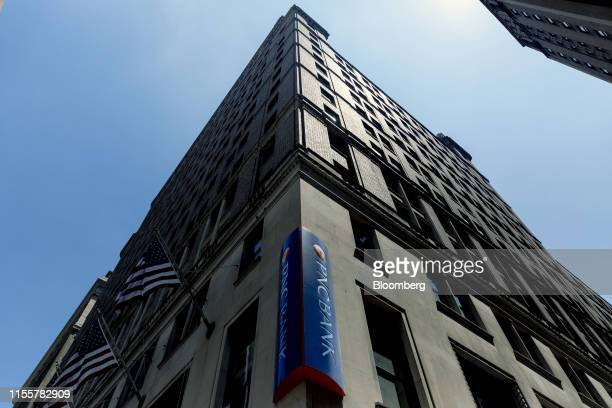 Signage is displayed next to American flags outside a PNC Financial Services Group Inc bank branch in New York US on Saturday July 13 2019 PNC...