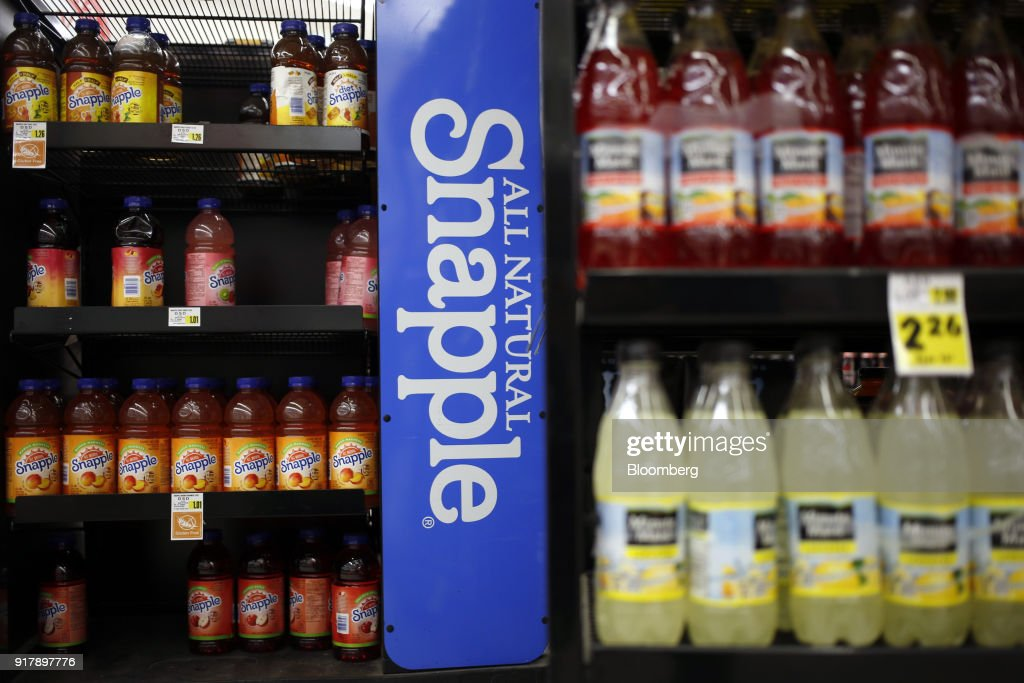 Signage is displayed next to bottles of Snapple brand beverages for sale at a grocery store in Louisville, Kentucky, U.S., on Tuesday, Feb. 13, 2018. Dr. Pepper Snapple Group Inc. is scheduled to release earnings figures on February 14. Photographer: Luke Sharrett/Bloomberg via Getty Images