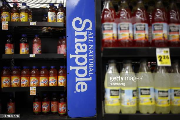 Signage is displayed next to bottles of Snapple brand beverages for sale at a grocery store in Louisville Kentucky US on Tuesday Feb 13 2018 Dr...
