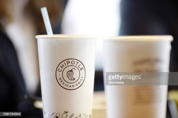 Signage is displayed on a cup at a Chipotle Mexican Grill Inc restaurant in Louisville Kentucky US on Saturday Feb 2 2019 Chipotle Mexican Grill Inc...
