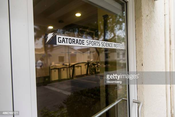 Signage is displayed on a door at the Gatorade Sports Science Institute at IMG Academy in Bradenton Florida US on Tuesday April 15 2014 The GSSI lab...