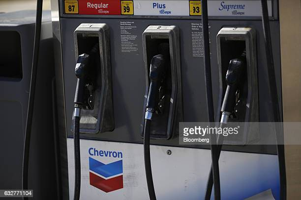 Signage is displayed on a fuel pump at a Chevron Corp gas station in Guild Tennessee US on Tuesday Jan 24 2017 Chevron Corp is expected to release...