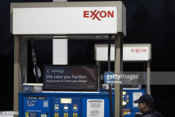 Signage is displayed on a fuel pump at an Exxon Mobil Corp gas station in Nashport Ohio US on Friday Jan 26 2018 Exxon Mobil Corp is scheduled to...