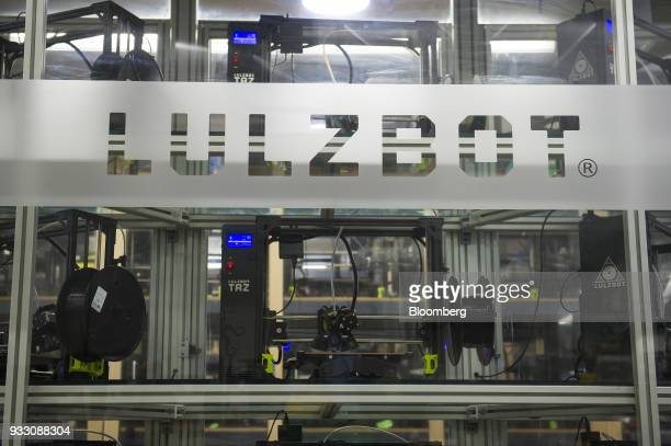 Signage is displayed on a glass window at the Aleph Objects Inc LulzBot 3D printers production facility in Loveland Colorado US on Wednesday March 14...
