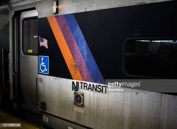 Signage is displayed on a New Jersey Transit train in Newark New Jersey US on Thursday Aug 9 2018 GovernorPhil Murphy on the job for seven months...