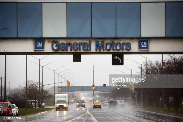 Signage is displayed on a pedestrian bridge near the General Motors Co Oshawa assembly plant in Oshawa Ontario Canada on Monday Nov 26 2018 General...