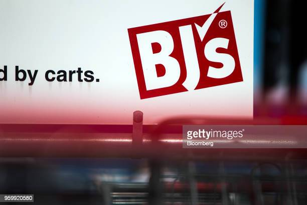 Signage is displayed on a shopping cart stand outside a BJ's Wholesale Club Holdings Inc location in Miami Florida US on Thursday May 17 2018 The...