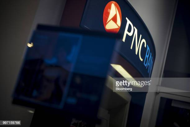 Signage is displayed on an automatic teller machine at a PNC Financial Services Group Inc bank branch in Chicago Illinois US on Tuesday July 10 2018...
