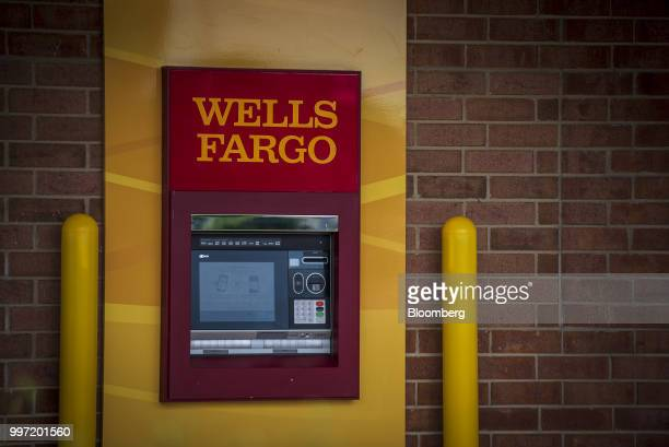 Signage is displayed on an automatic teller machine outside a Wells Fargo Co bank branch in Niles Illinois US on Tuesday July 10 2018 Wells Fargo Co...