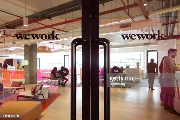 Signage is displayed on glass doors at the WeWork Cos. 32nd Milestone co-working space in Gurugram, India, on Monday, Feb. 18, 2019. The New...