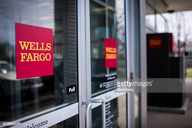 Signage is displayed on the door of a Wells Fargo Co bank branch in Evanston Illinois US on Monday April 11 2016 Wells Fargo Co is scheduled to...