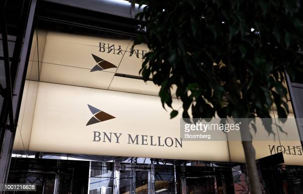 A person enters a Bank of New York Mellon Corp office building in New York US on Thursday July 12 2018 The Bank of New York Mellon Corp is scheduled...