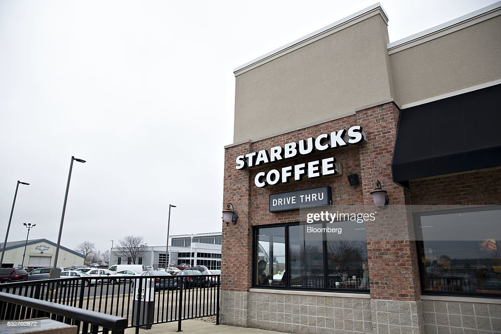 Signage is displayed on the exterior of a Starbucks Corp. coffee shop in Peoria, Illinois, U.S., on Wednesday, Jan. 25, 2017. Starbucks Corp. is expected to release earnings figures on January 26. Photographer: Daniel Acker/Bloomberg via Getty Images